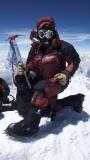 Mountain Guide Vern Tejas wearing Forty Below Purple Haze on Everest summit 2013. Photo by: JM Horst
